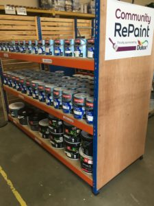 Paint display at the Community RePaint Highlands scheme, showing a range of cheap and recycled paint for sale.
