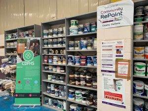 Paint display at the Community RePaint Country Durham scheme, showing a range of cheap and recycled paint for sale.