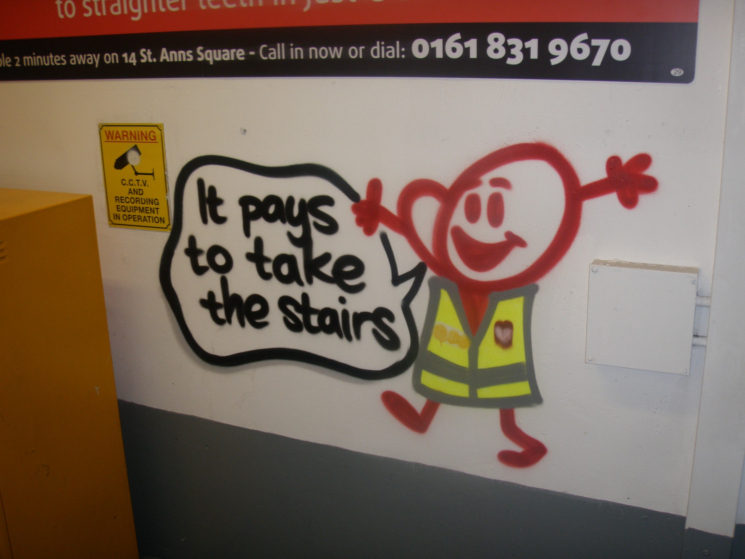 Mural that reads: it pays to take the stairs