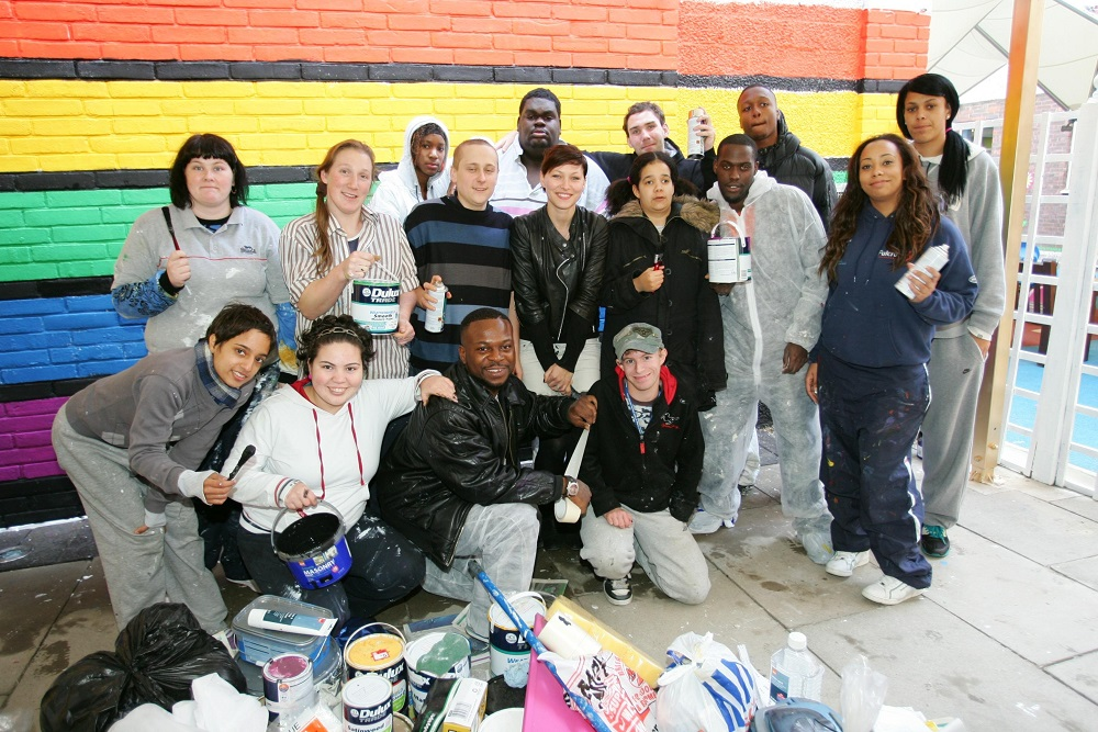 The Prince's trust paint volunteers group photo.