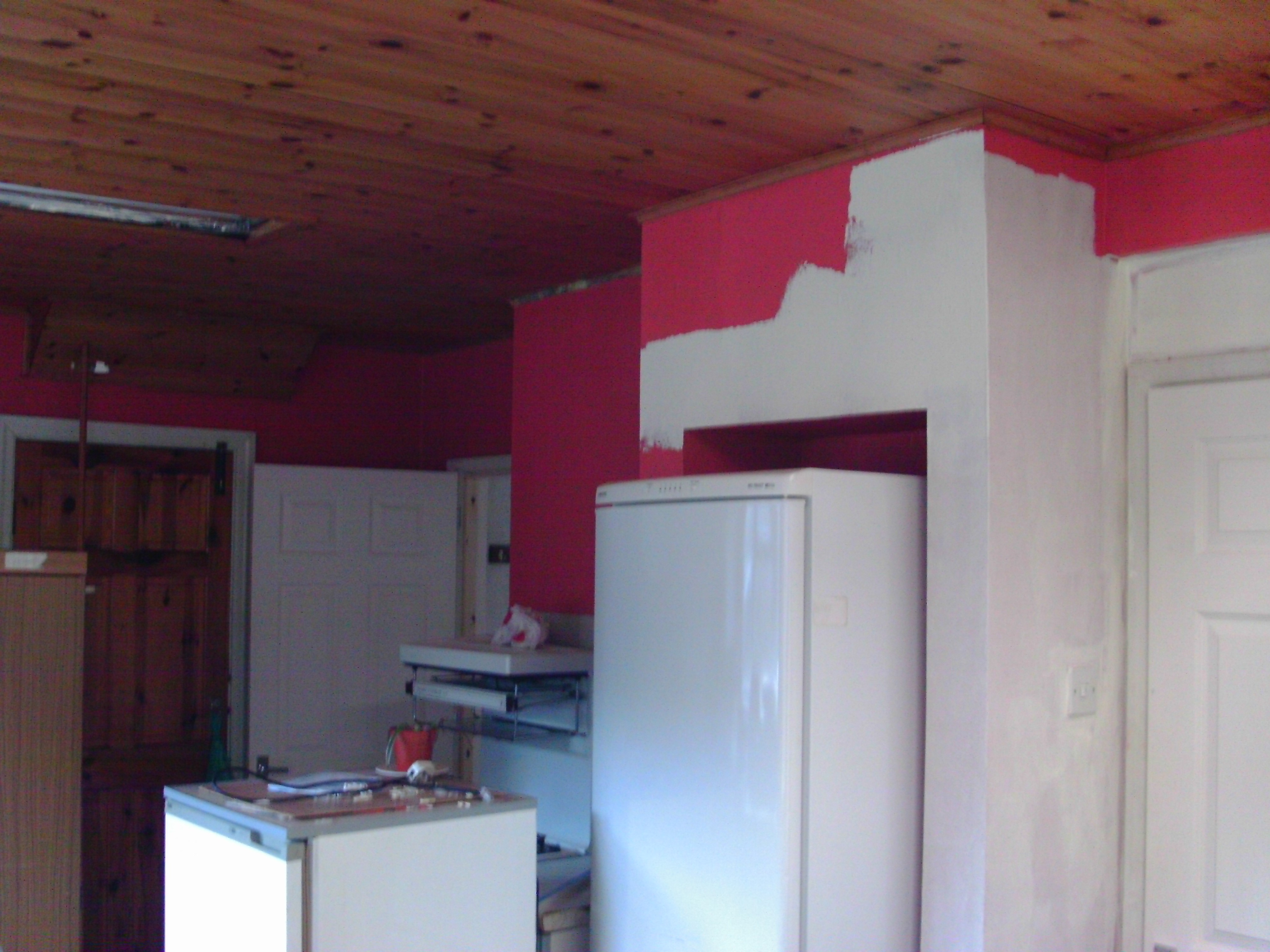 Painting underway - changing the colour in the kitchen from bright red to white