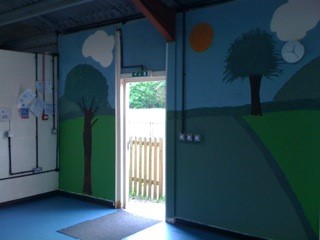 RePainted Pre-School with field and trees mural
