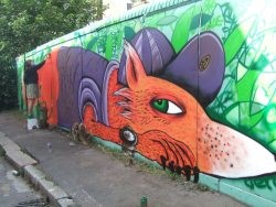 The finished community mural of a fox.