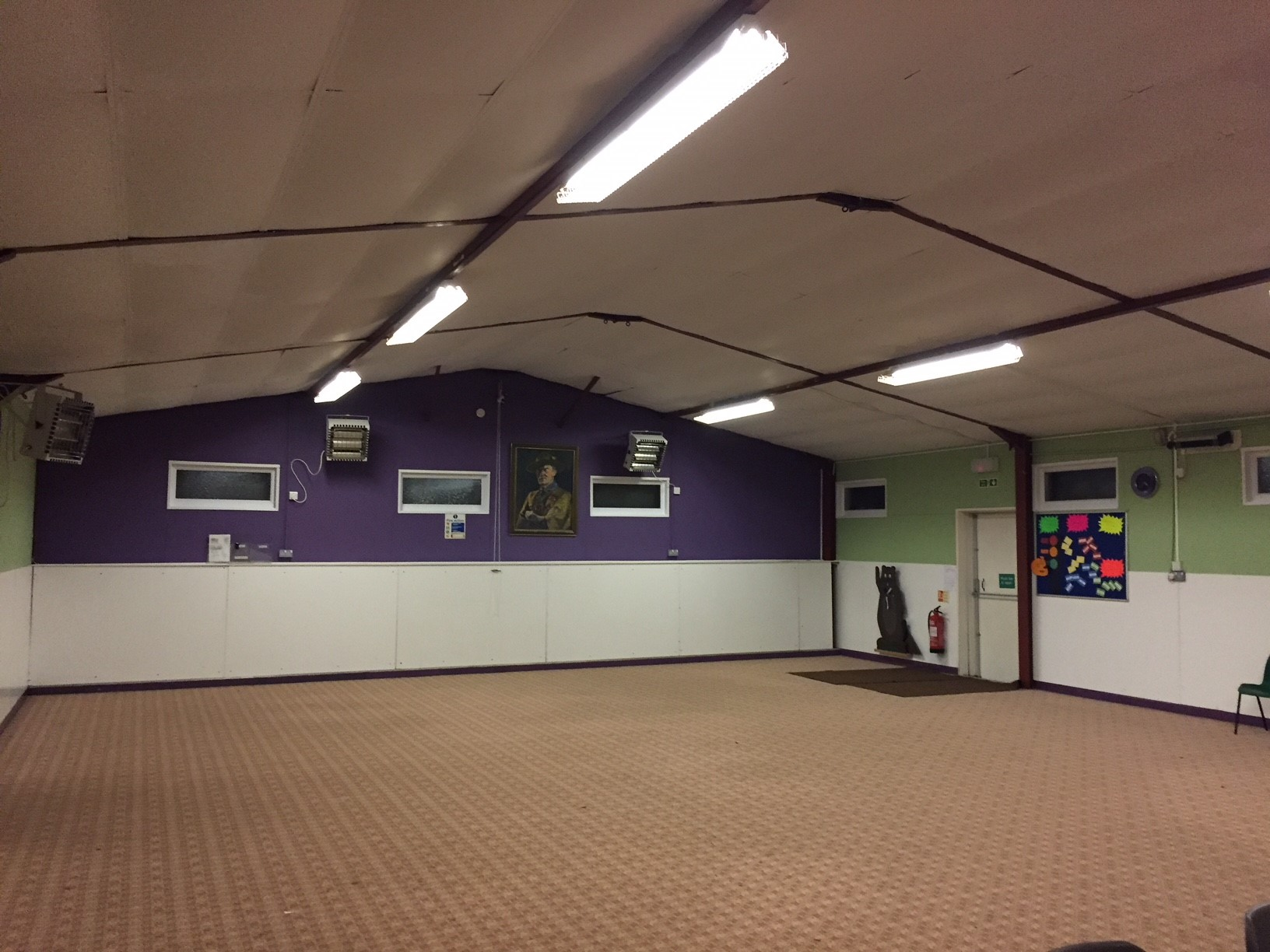 Newly painted scout hut in purple and green