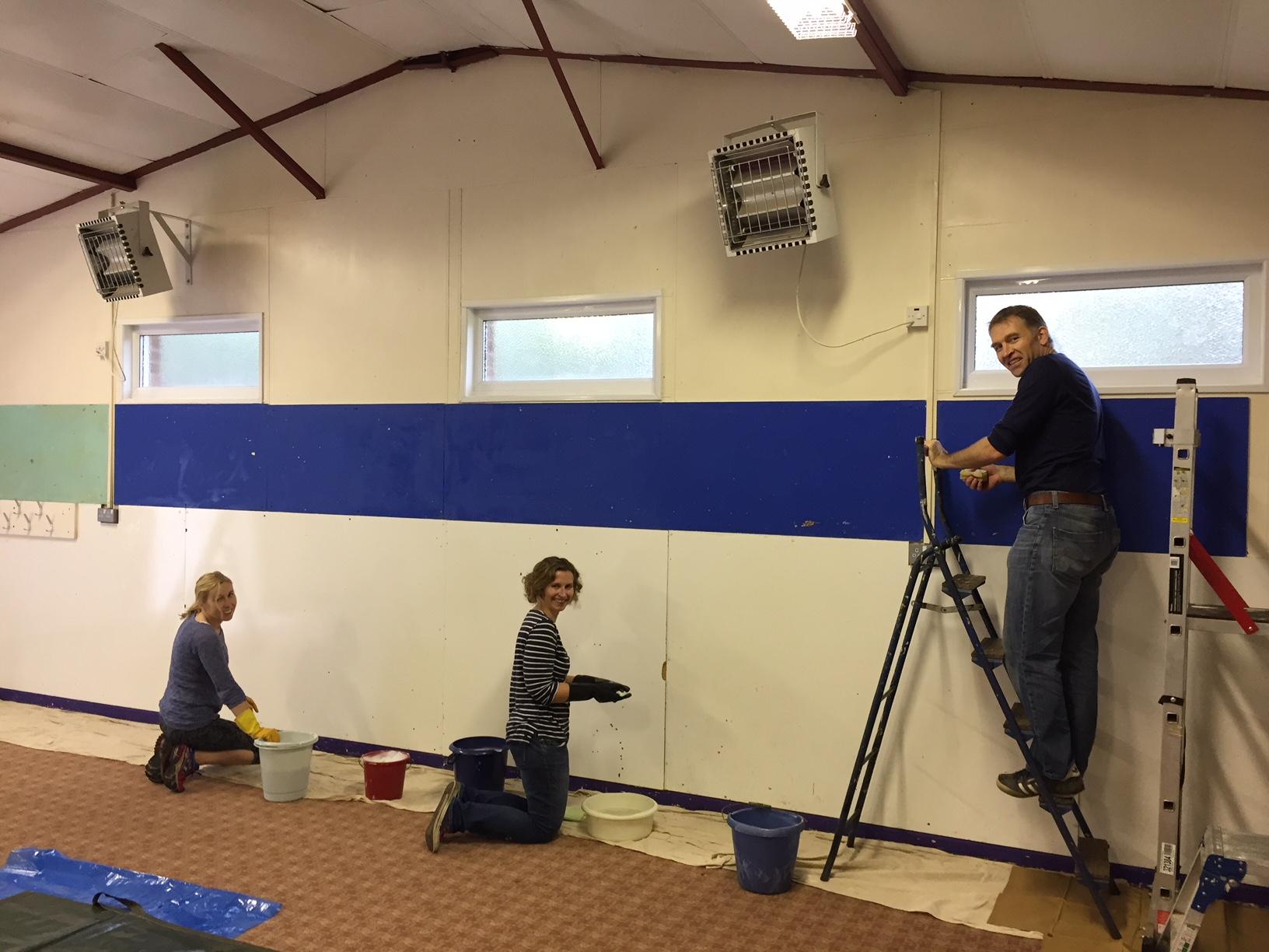 scout hut being repainted by volunteers