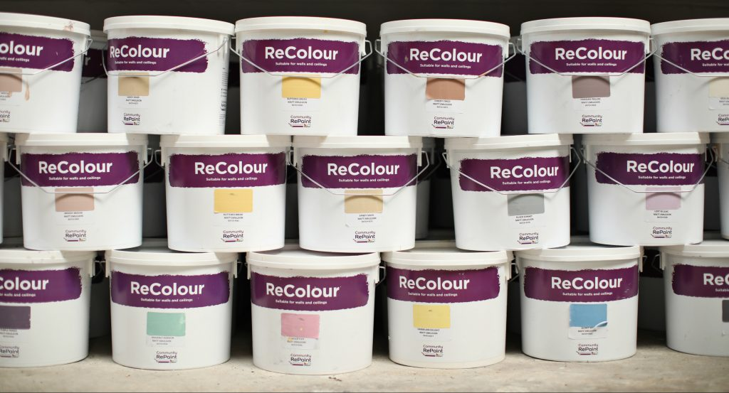 A photo of a selection of our affordable, low-cost and environmentally friendly ReColour emulsion paint in a range of colours for sale at Emmaus Bolton.