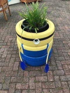 painted tyre turned planter