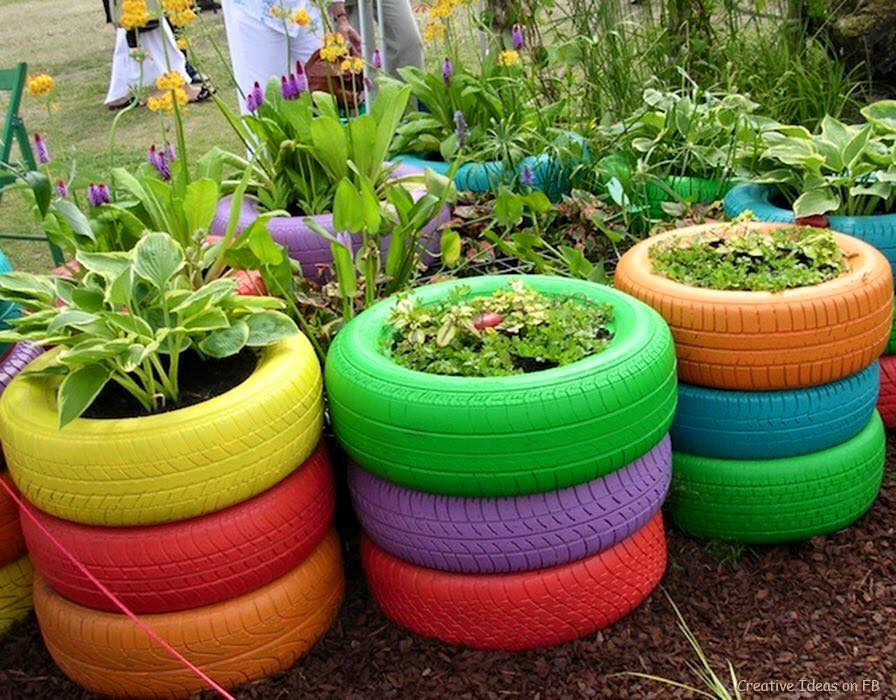 painted car tyres turned into planters
