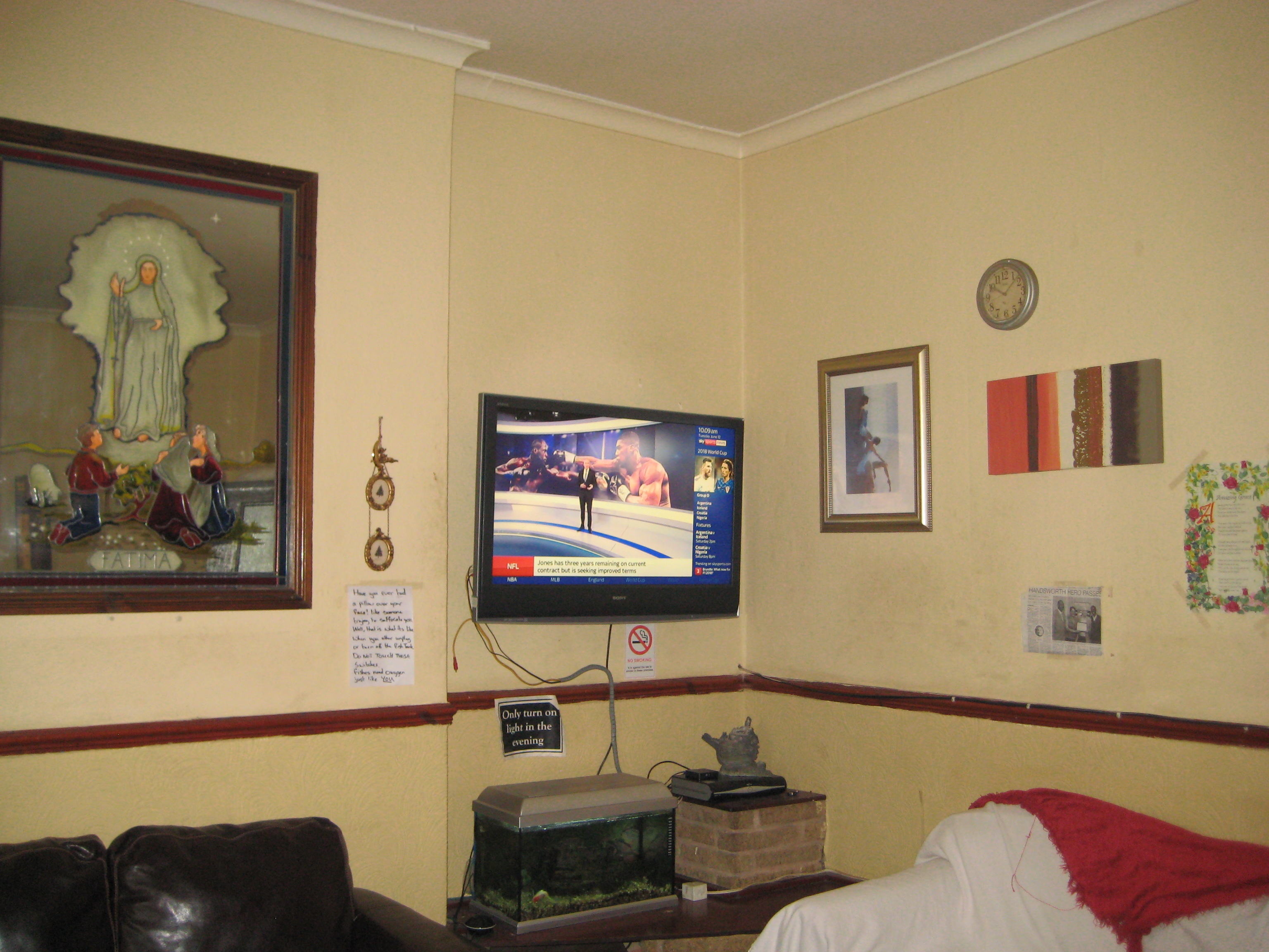 Before redecoration of living area at Community RePaint Sandwell and Soho.