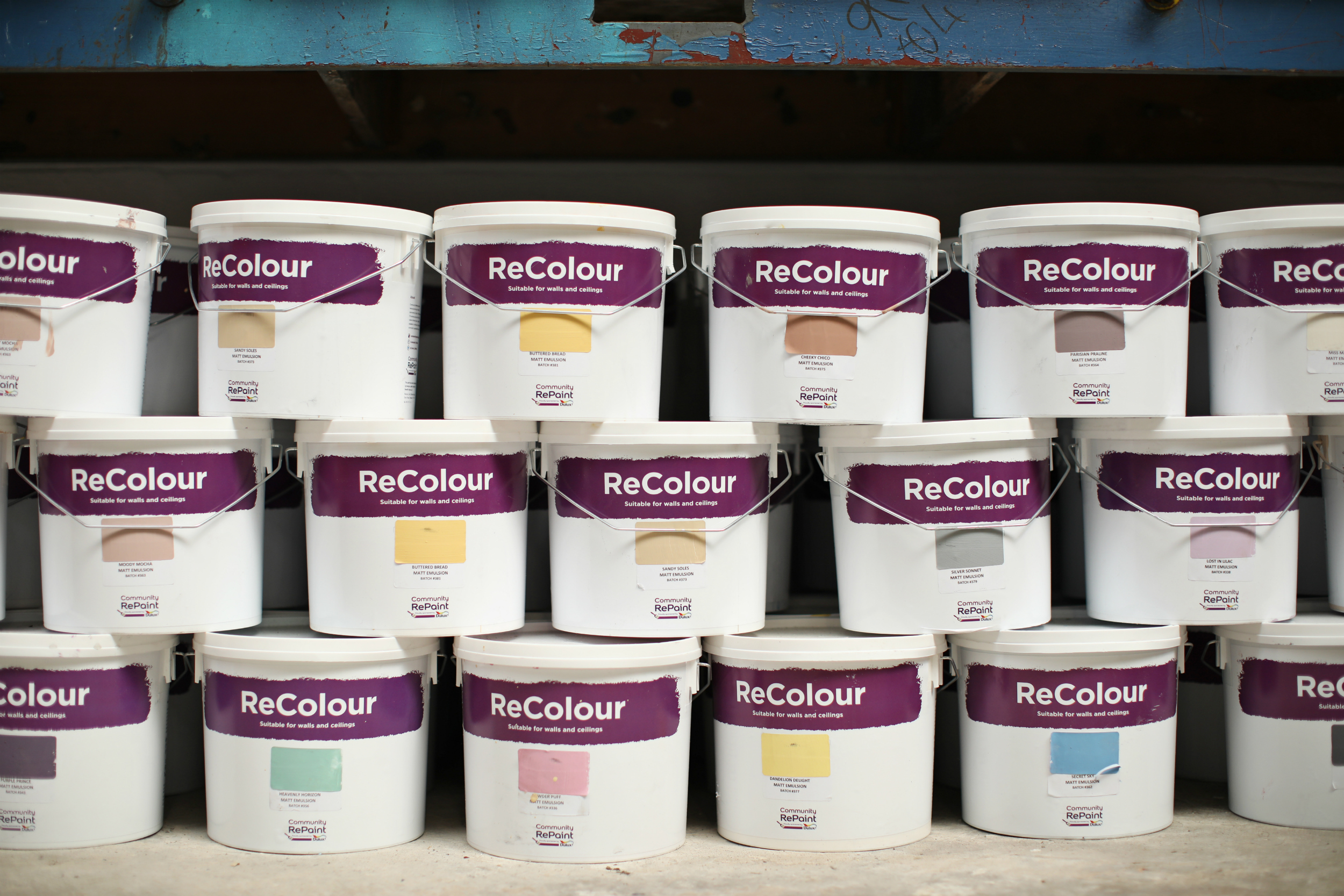 A photo of a range of our low cost and environmentally friendly paint. The ReColour matt emulsion paint and silk emulsion paint is sold in 5 litre plastic containers.