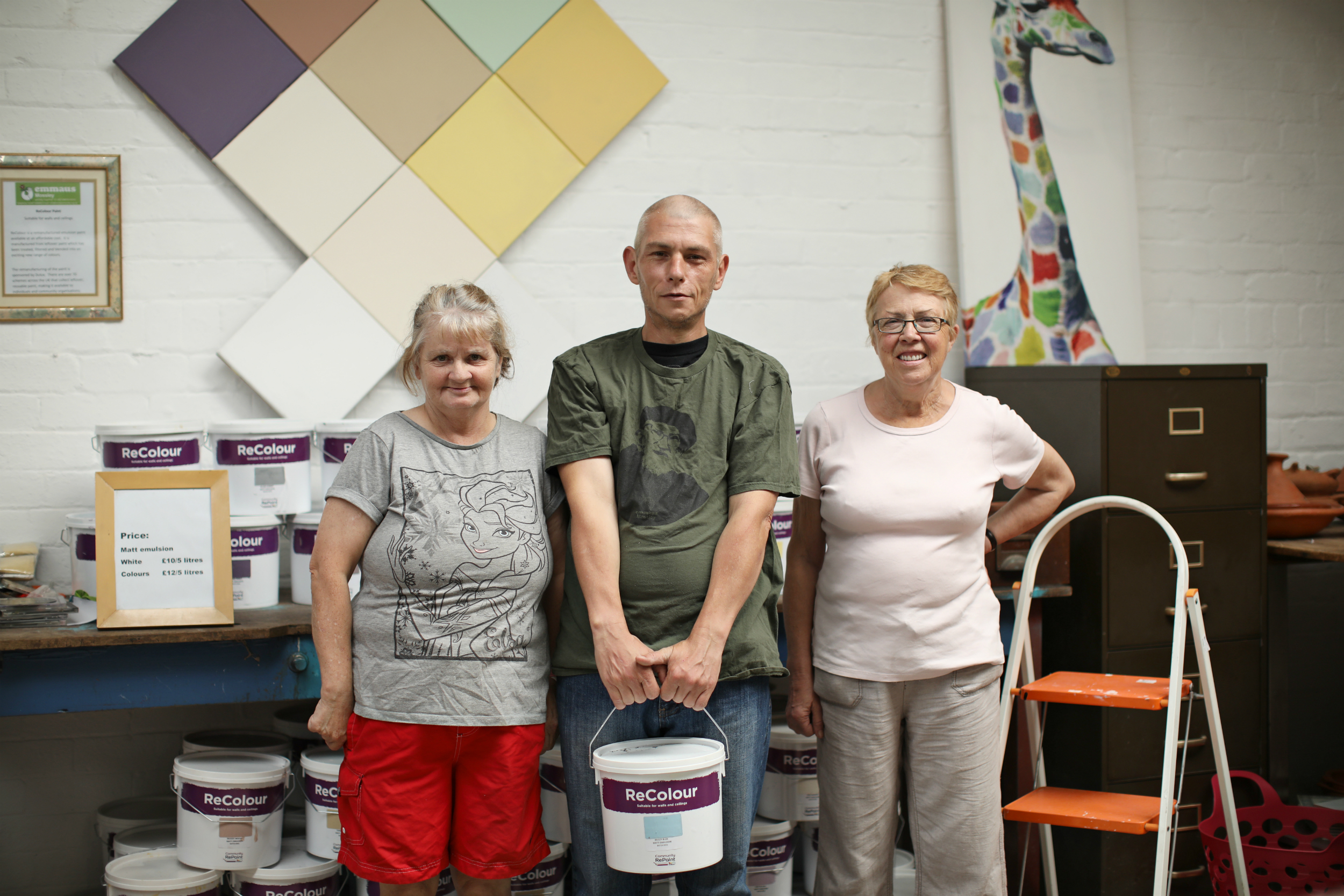 Staff pose with ReColour emulsion paint.