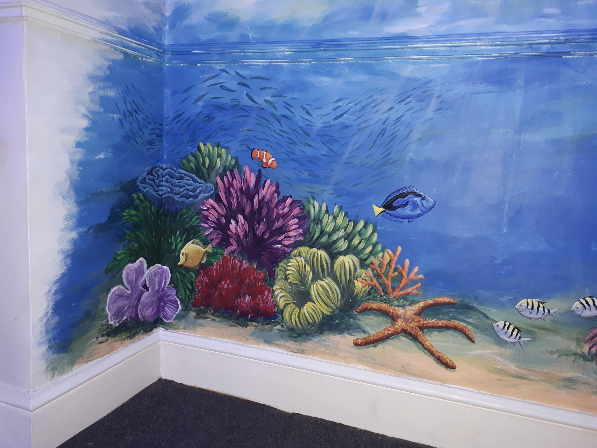 Community wall painted mural using cheap and affordable recycled paint from Community RePaint scheme.