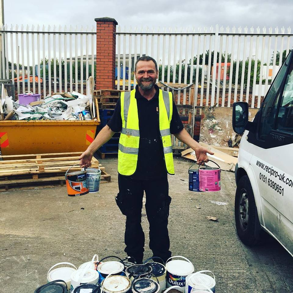 man holding paint containers