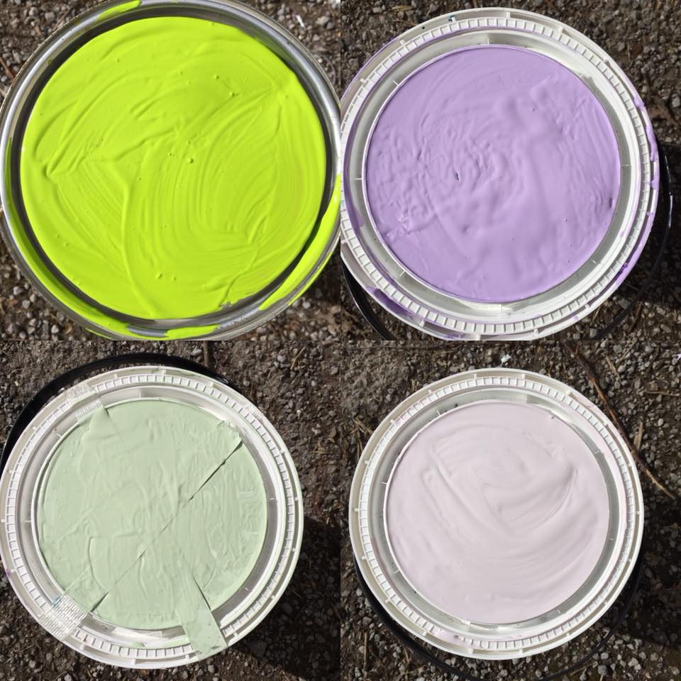 painted tin lids in bright green, purple and pale green and purple paint.