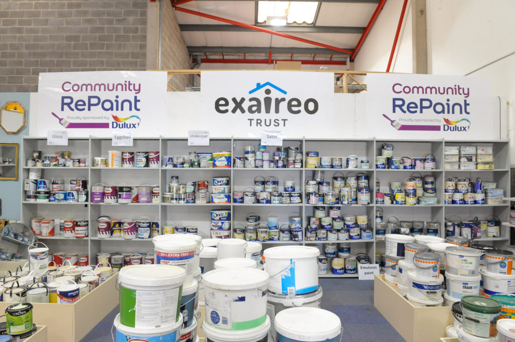 Paint display selling cheap and reusable paint at a Community RePaint Scheme.