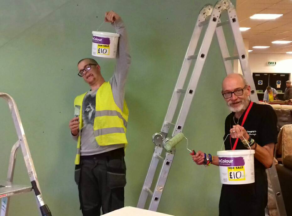 Volunteer painter at Community RePaint Cheshire painting with affordable ReColour emulsion.