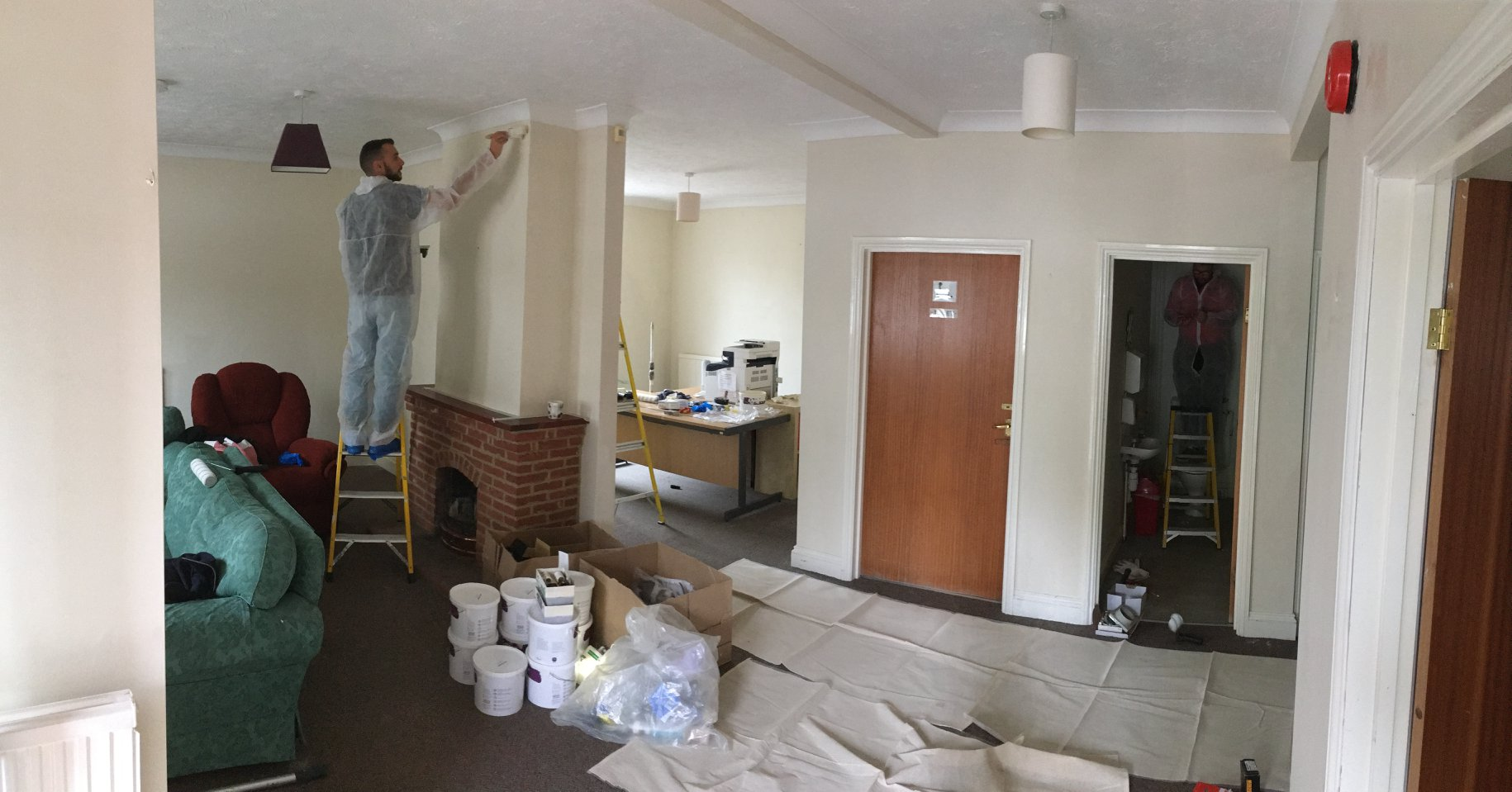 Paint volunteers give a makeover to a cancer support centre.