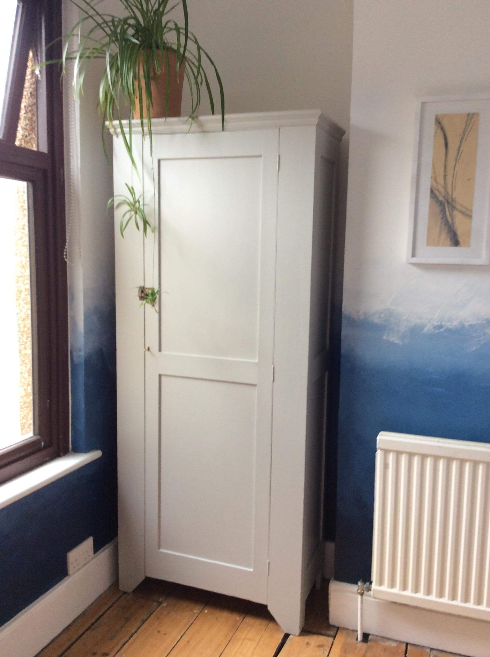 Upcycling project - Upcycled wardrobe using recycled paint from Community RePaint Bristol City. The warddrobe has been painted with grey paint.