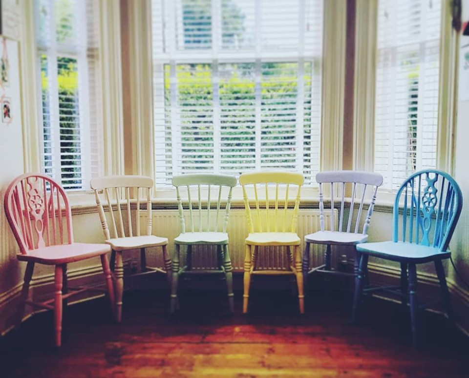 Redecorated dining chairs in pastel emulsion.
