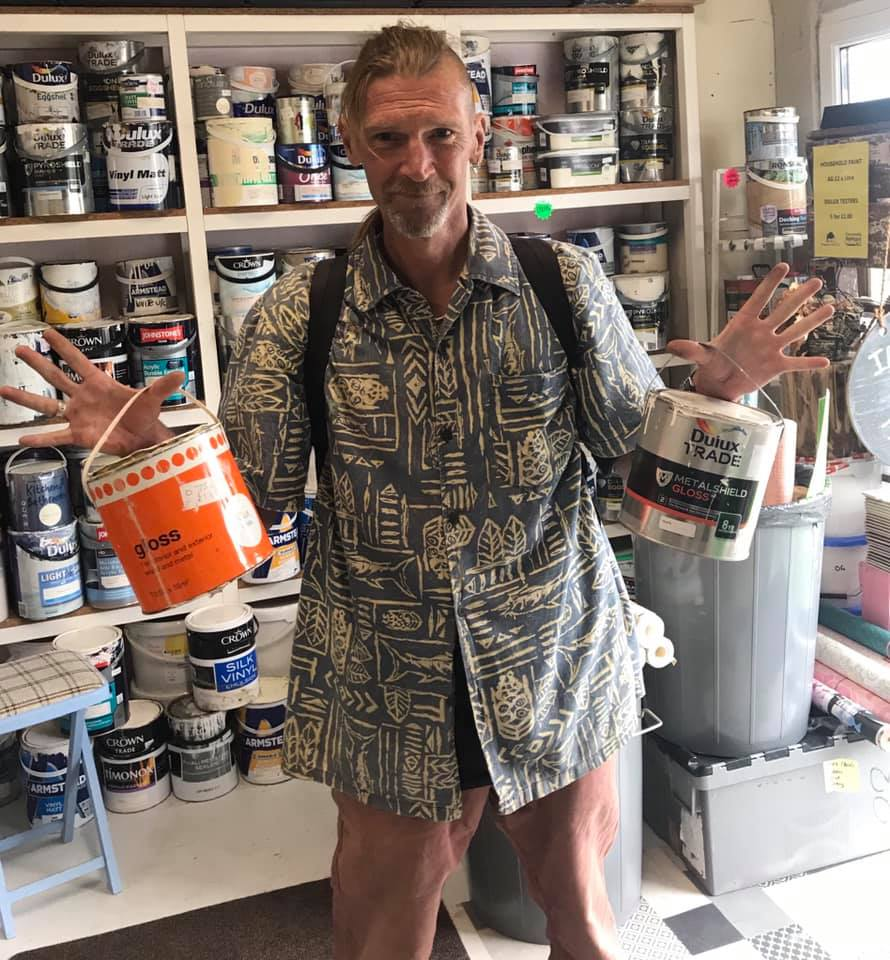 Ian in Cornwall picking up paint from Community RePaint Cornwall to paint his local benches.