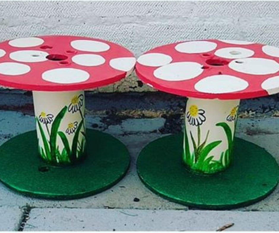 Upcycled cable reel that has been turned into a painted Fairy Garden, using cheap and recycled paint from Community RePaint Coventry.