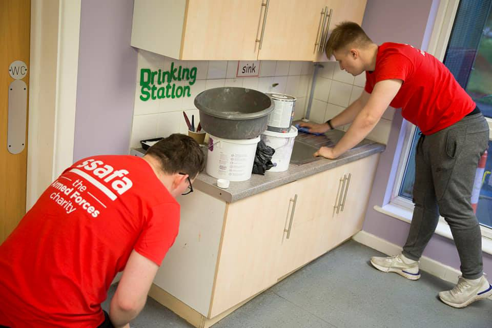 Volunteer painters using low cost environmentally friendly ReColour emulsion paint.