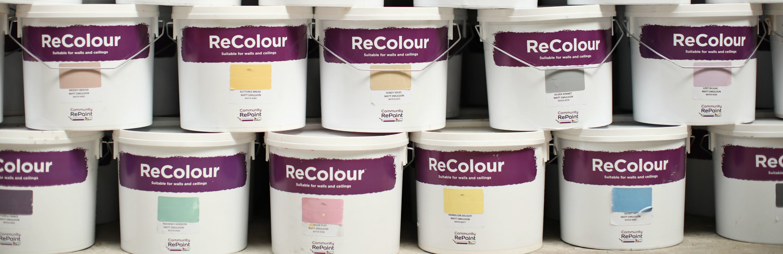 A selection of our affordable and environmental ReColour emulsion paint in a variety of colours, including, grey paint, yellow paint, blue paint, green paint and pink paint.