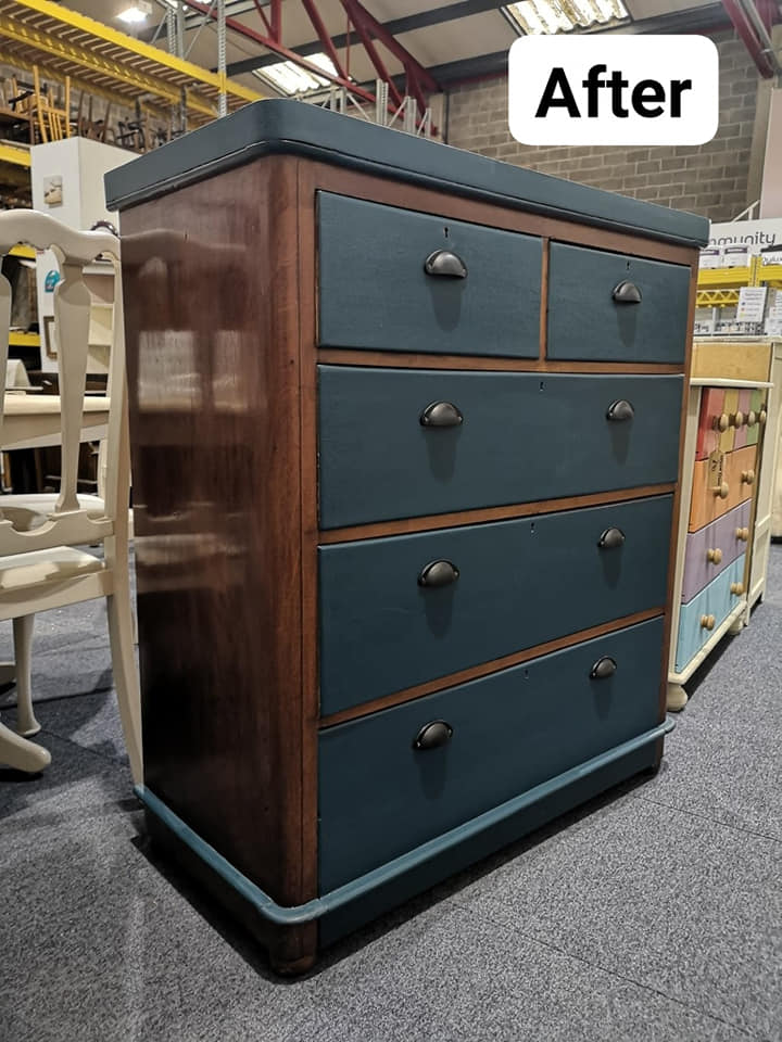 After upcycling photo of chest of drawers - the sides have been polished and the drawers have been painted dark blue/grey.