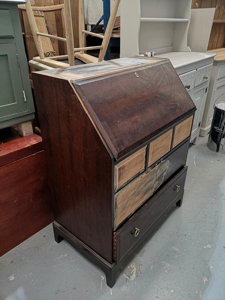 Before upcycling photo of bureau - showing brown wood veneer.