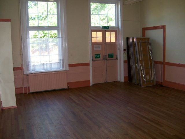 Before redecoration photos of community hall.