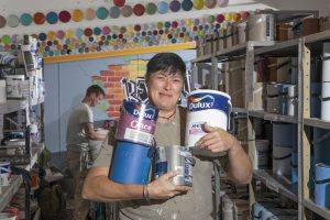 Community RePaint Bradford manager Karen Hutchinson and volunteer Lawrence Knowles process reusable paint. Dulux sponsor community RePaint.