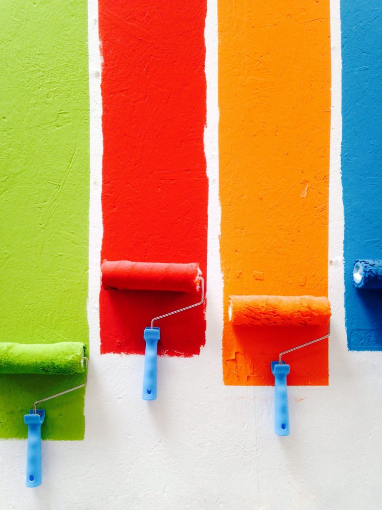 Image of rollers painting different colours