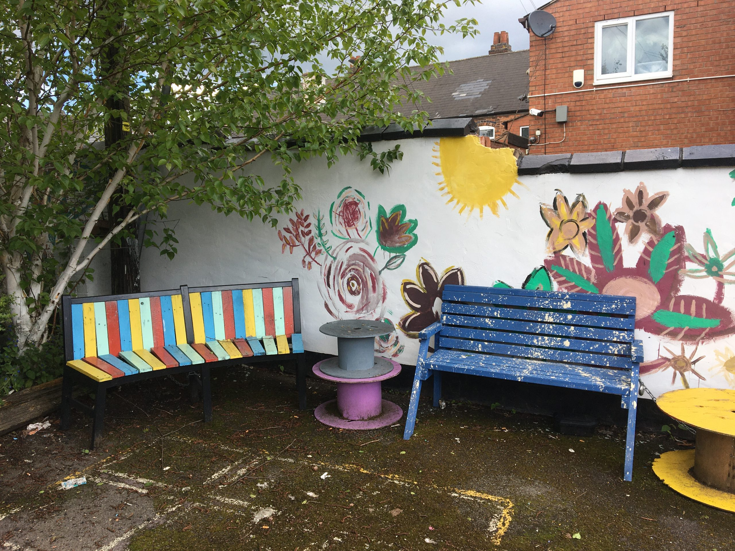 Photo of upcycled benches using paint from the scheme
