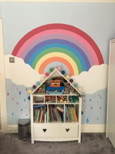 Rainbow painted in children's bedroom using paint from RePaint Bradford