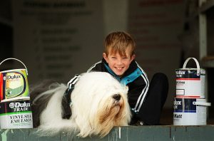 Child with Dulux dog during launch of Community RePaint Derby 2000